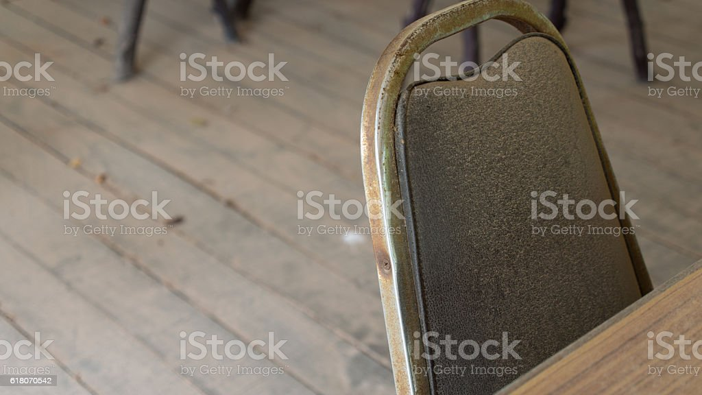 An Abandoned House with a Chair stock photo