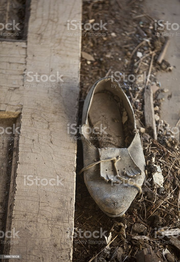 An abandoned old shoe in the dirt royalty-free stock photo