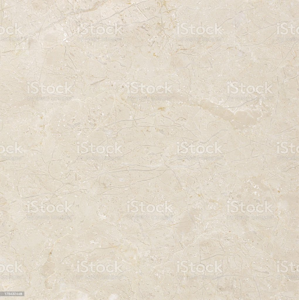 An abstract background made of a beige marble stock photo