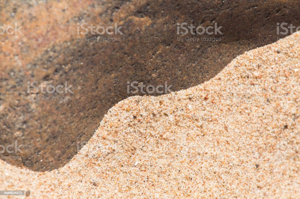 An abstract background of a sea sand and rock shapes stock photo