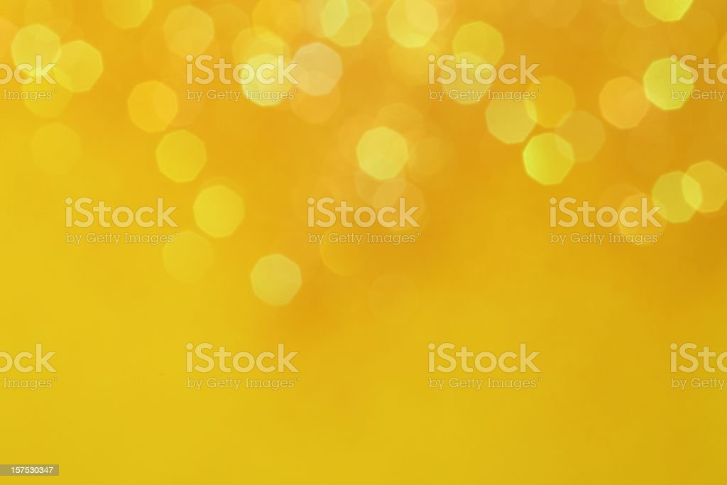 An abstract background of golden lights royalty-free stock photo