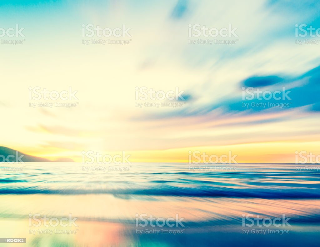 An abstract seascape with blurred zoom motion on paper backgroun stock photo
