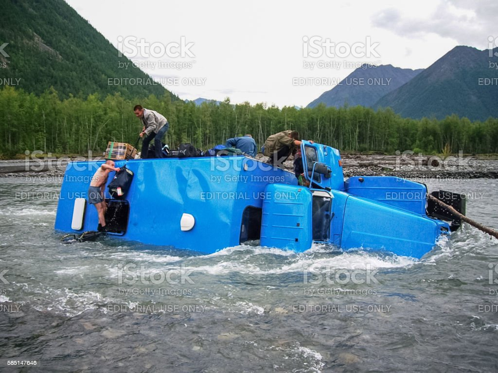 An accident while crossing a mountain stream stock photo