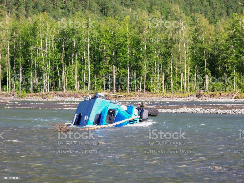An accident while crossing mountain stream stock photo