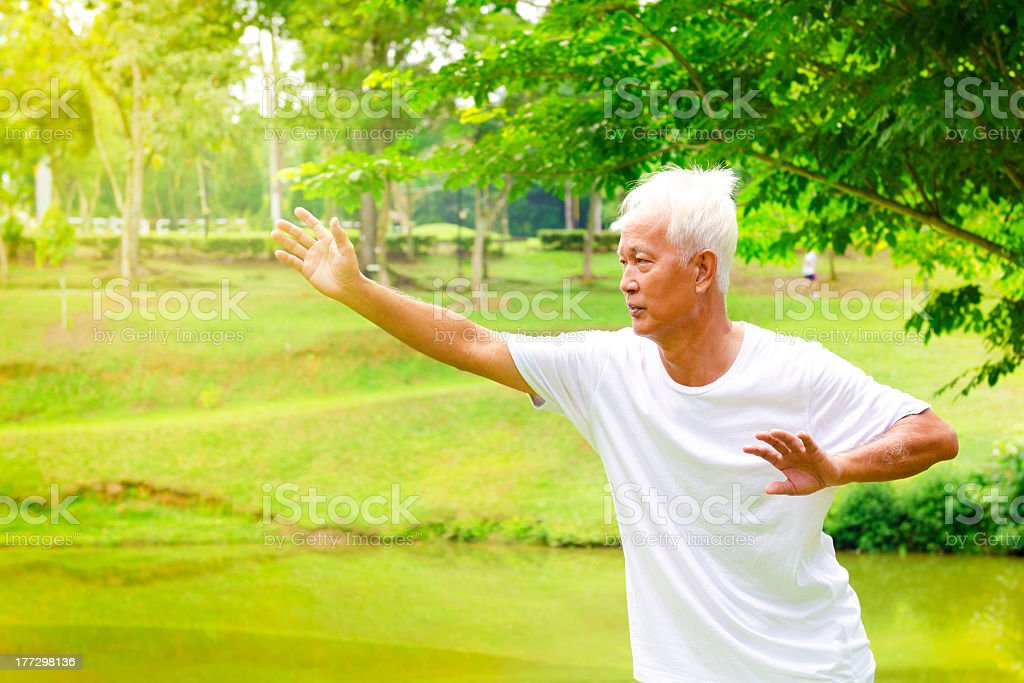 An active senior outside exercising  stock photo
