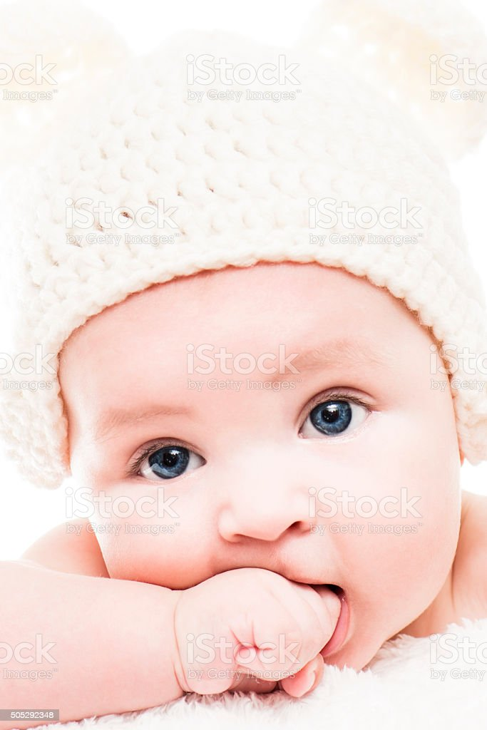 An adorable baby looking at camera stock photo