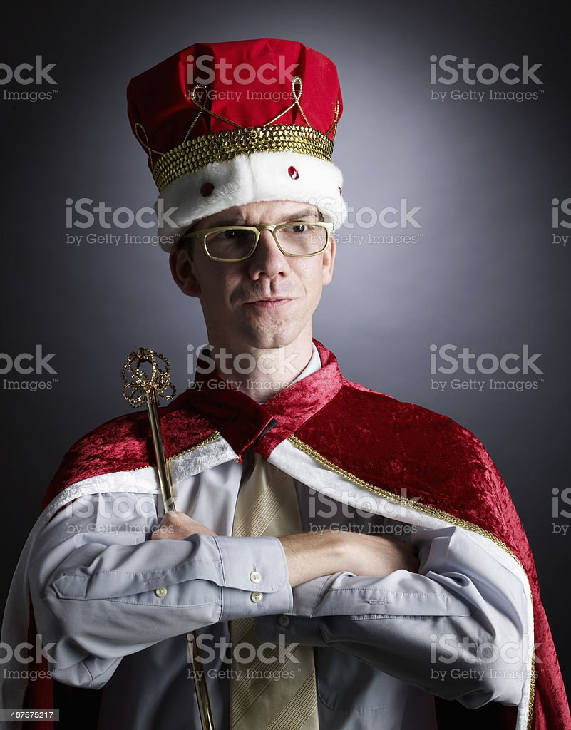An adult man pretending to be king stock photo