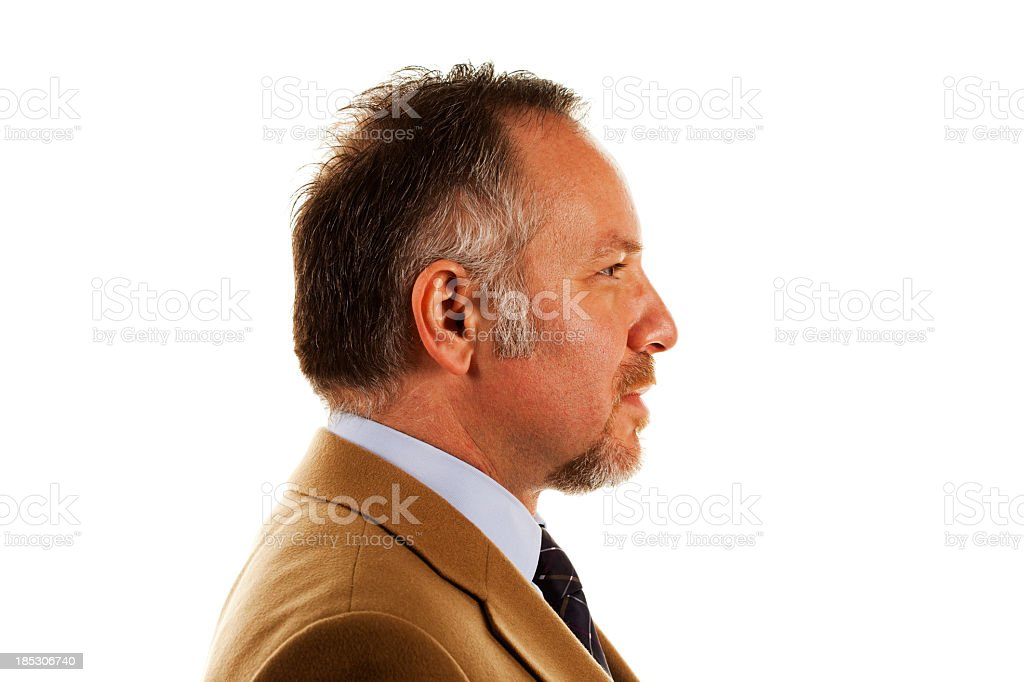 An adult man sitting sideways on a white background royalty-free stock photo