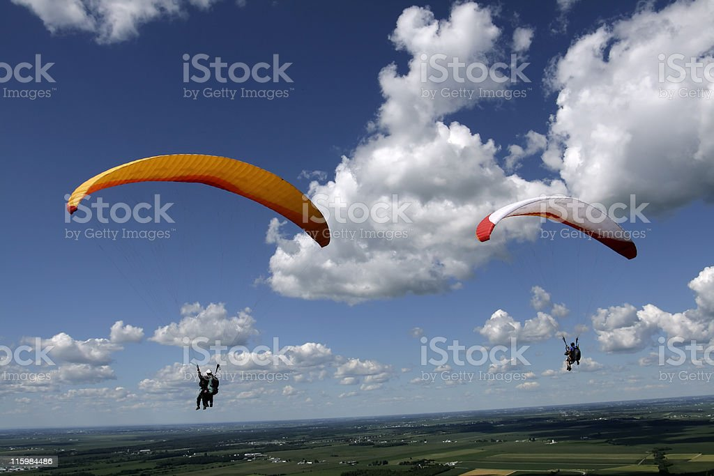 An Adventure of a Lifetime in Tandem Paragliding stock photo