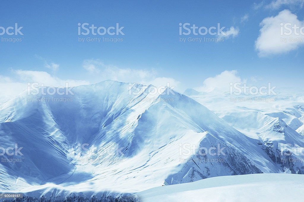 An aerial overview of snow capped mountains royalty-free stock photo