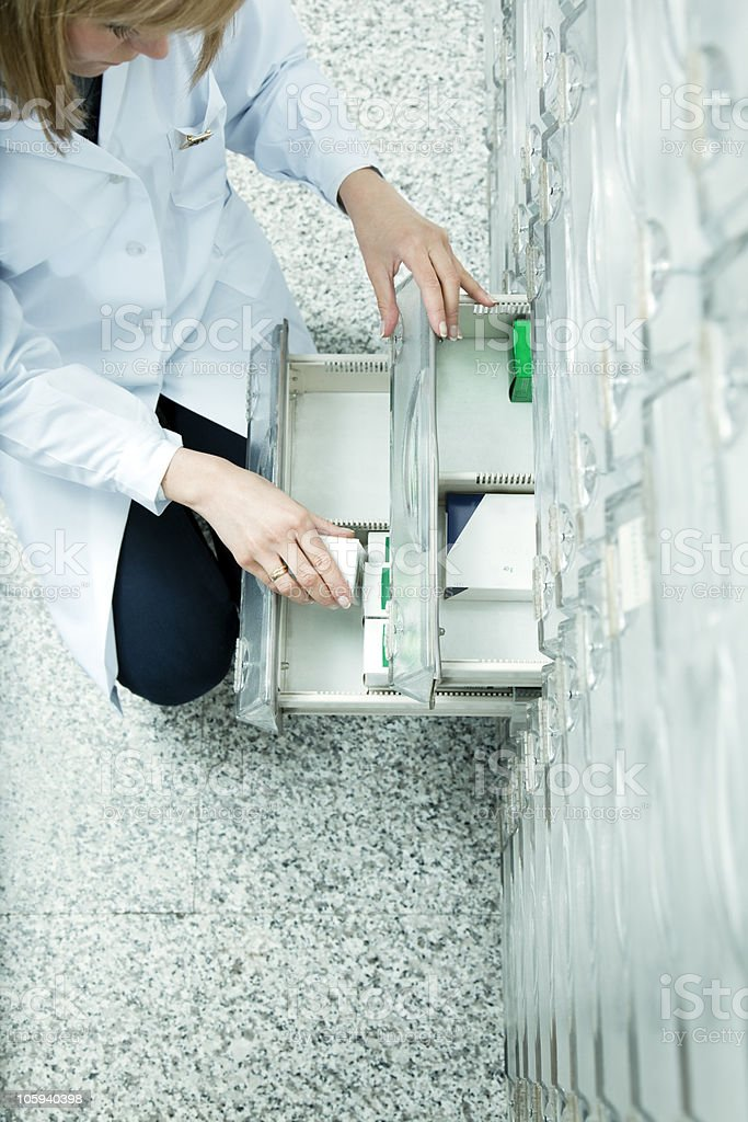 An aerial picture of a pharmacist looking for medication stock photo