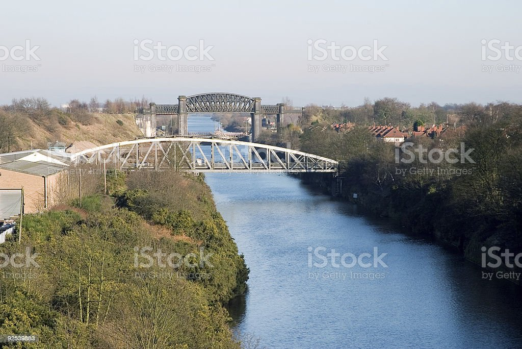 An aerial view of a bridge across the river  stock photo