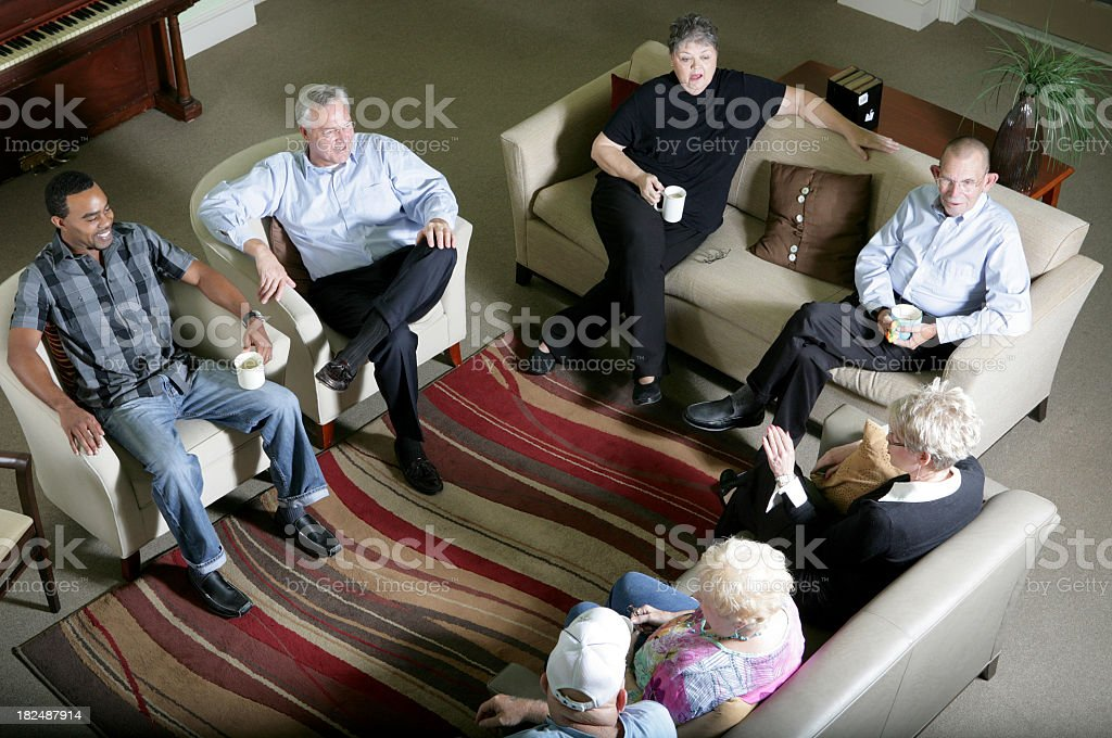 An aerial view of a group of people on couches royalty-free stock photo