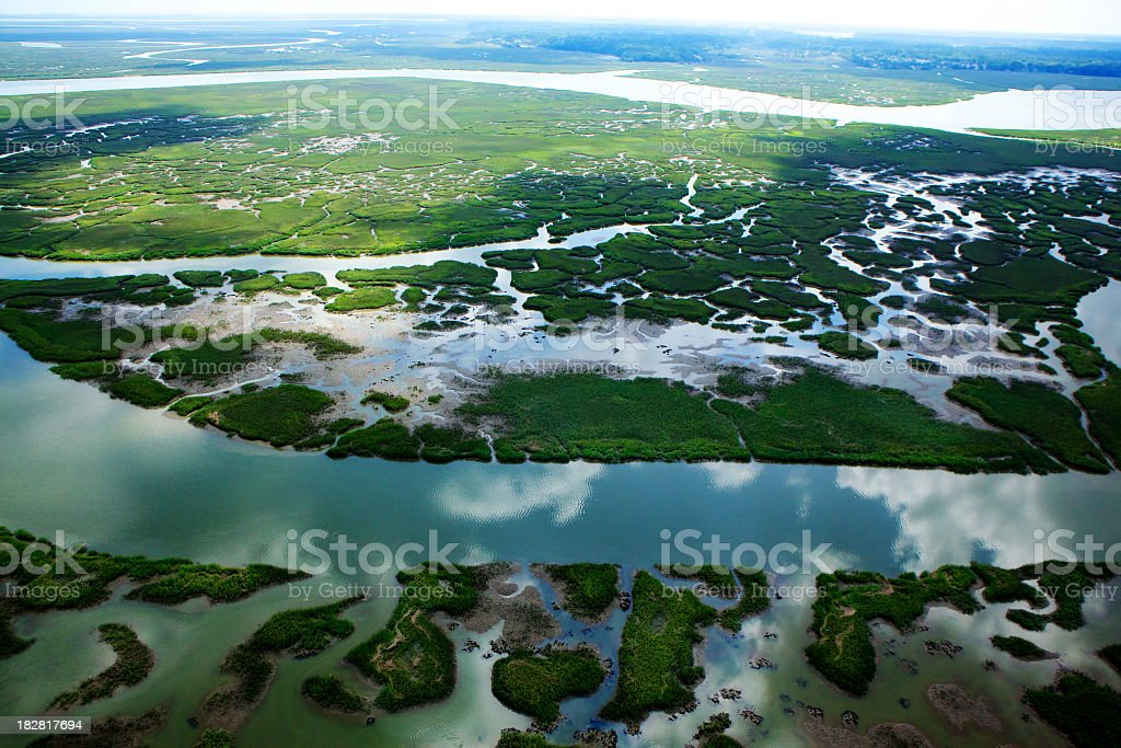 An aerial view of a stream cutting across a floodplain stock photo
