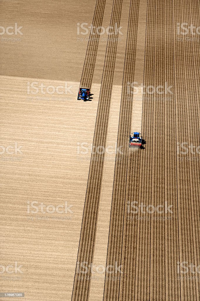 An aerial view of fields being plowed royalty-free stock photo