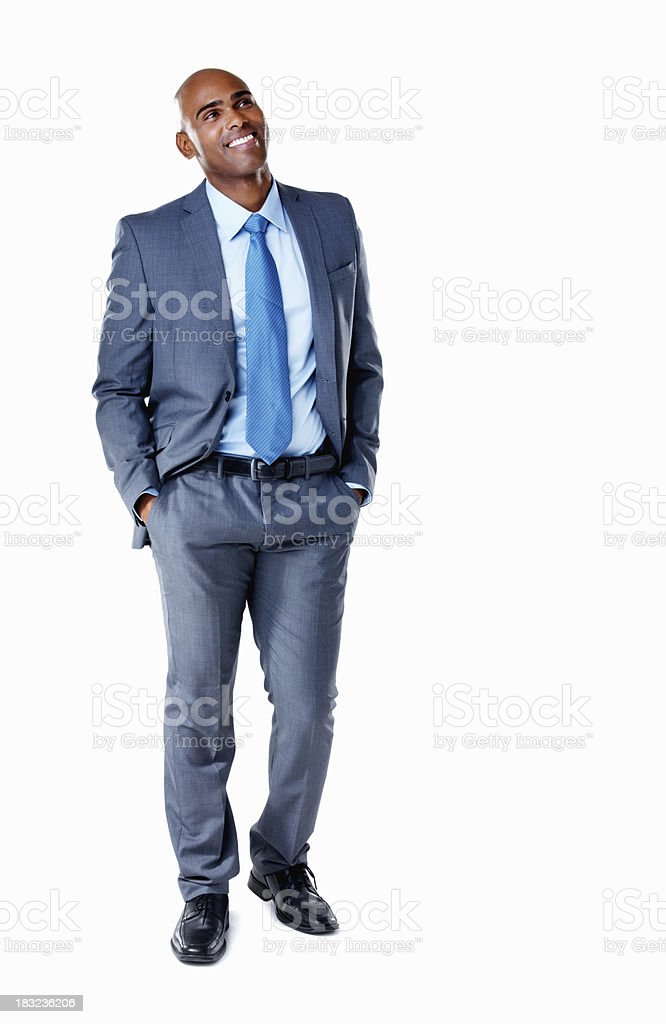 An African American business man standing with hands in pockets royalty-free stock photo