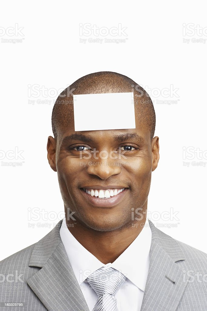 An African American man with card on his head royalty-free stock photo