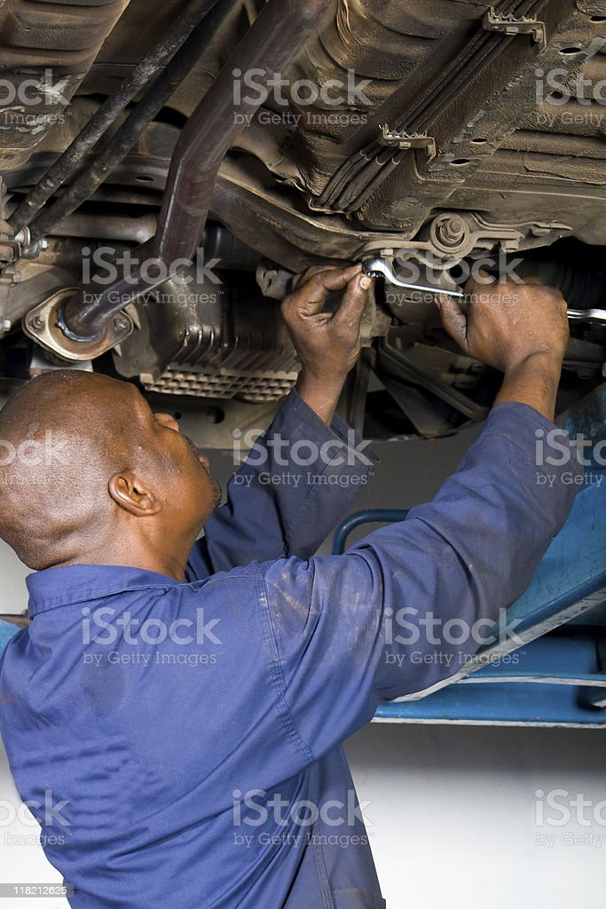 An African American. Mechanic in a blue uniform royalty-free stock photo