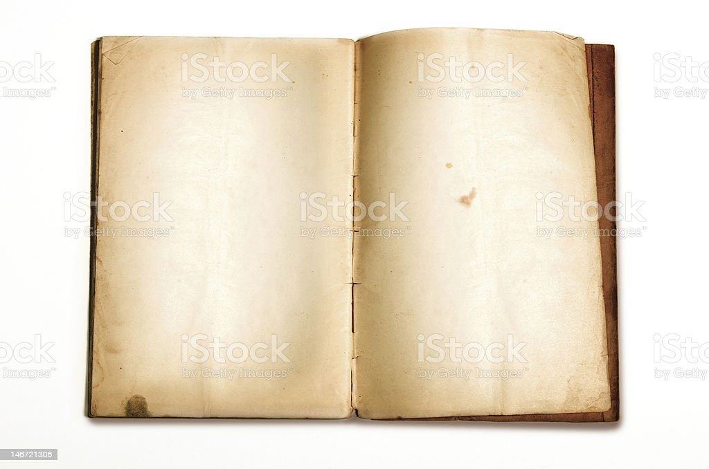 An aged ancient book on a white background royalty-free stock photo