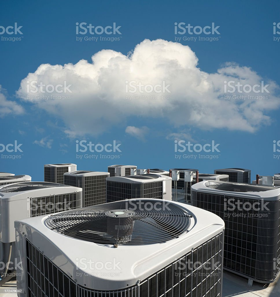 An air conditioning unit outside of a building  royalty-free stock photo