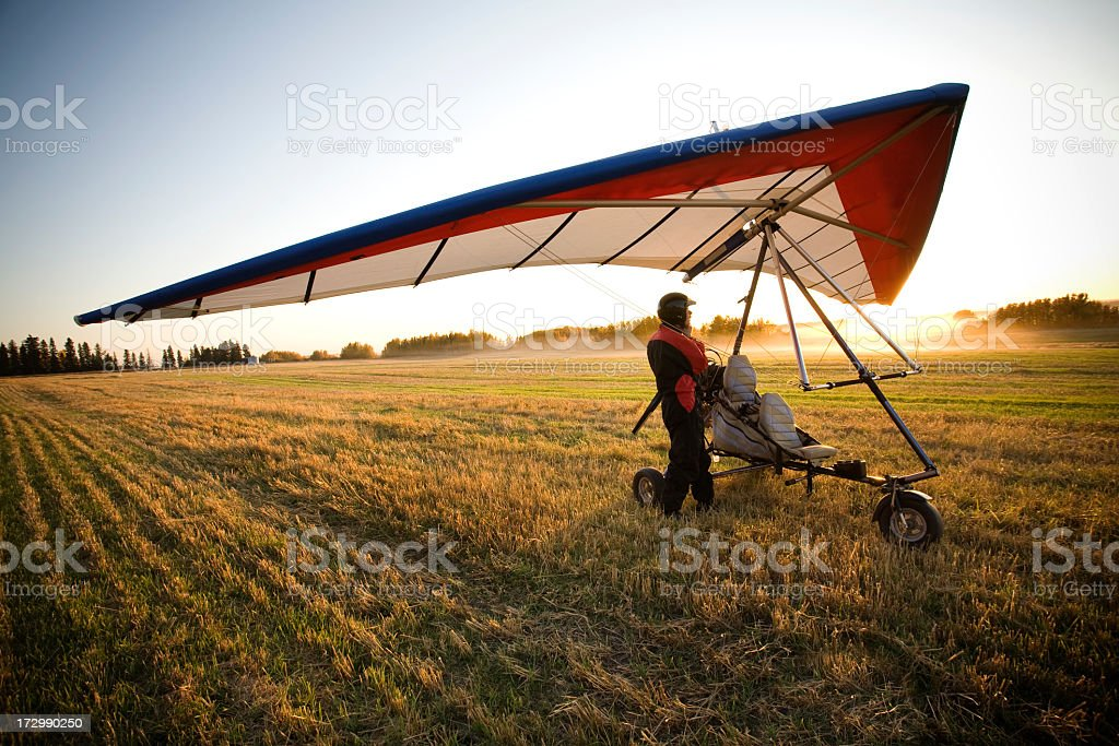 An air glider at sunrise preparing for takeoff stock photo