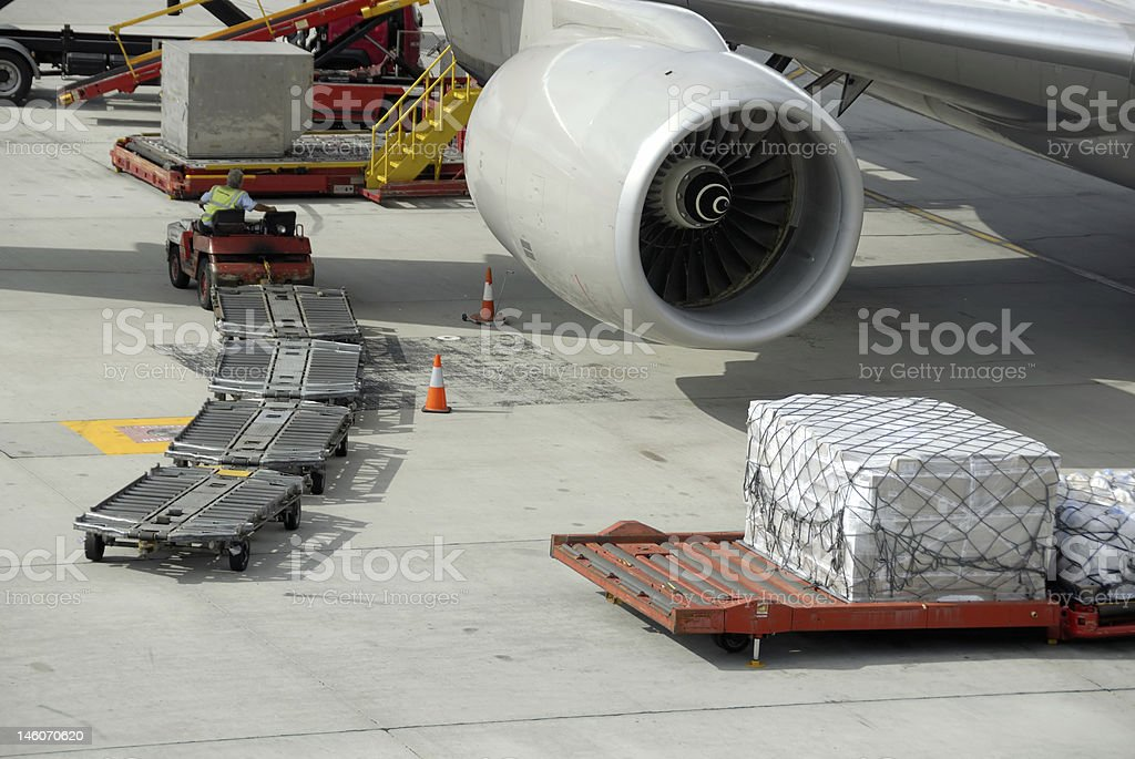 An aircraft waiting to load cargo stock photo