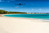 An Airplane approaching Exuma (Bahamas) over Emerald Bay