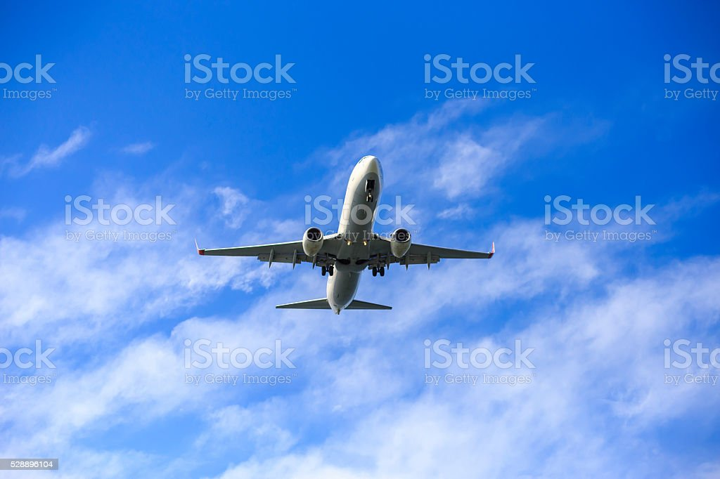 an airplane low pass stock photo