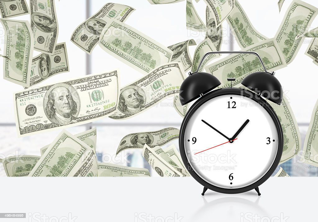 An alarm clock is on the table. stock photo