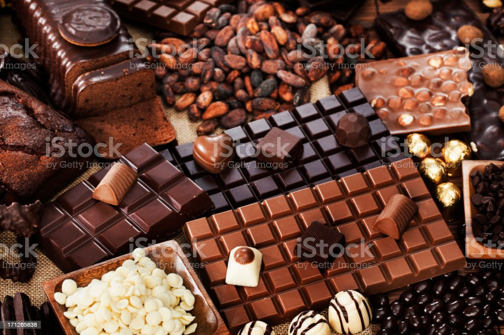 An amazing chocolate collection with cocoa beans stock photo