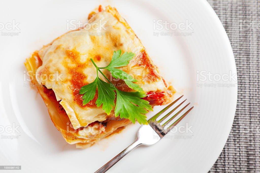 An amazing Italian dish of lasagna on a clean white plate stock photo