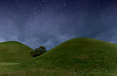 An amazing night field and magic sky with stars