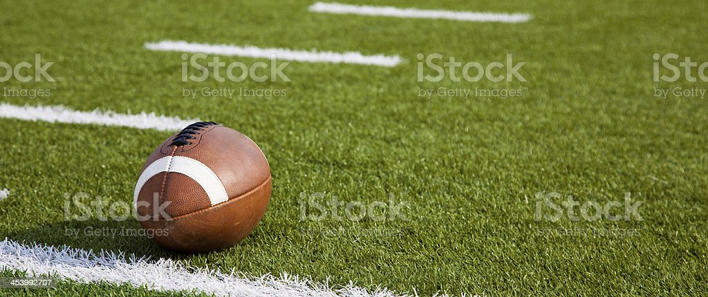An American football on field stock photo