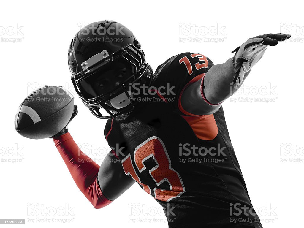 An American football player throwing the football stock photo