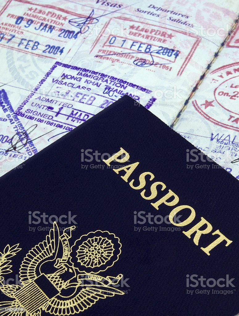 An American passport on top of Thai travel pages from 2004 royalty-free stock photo