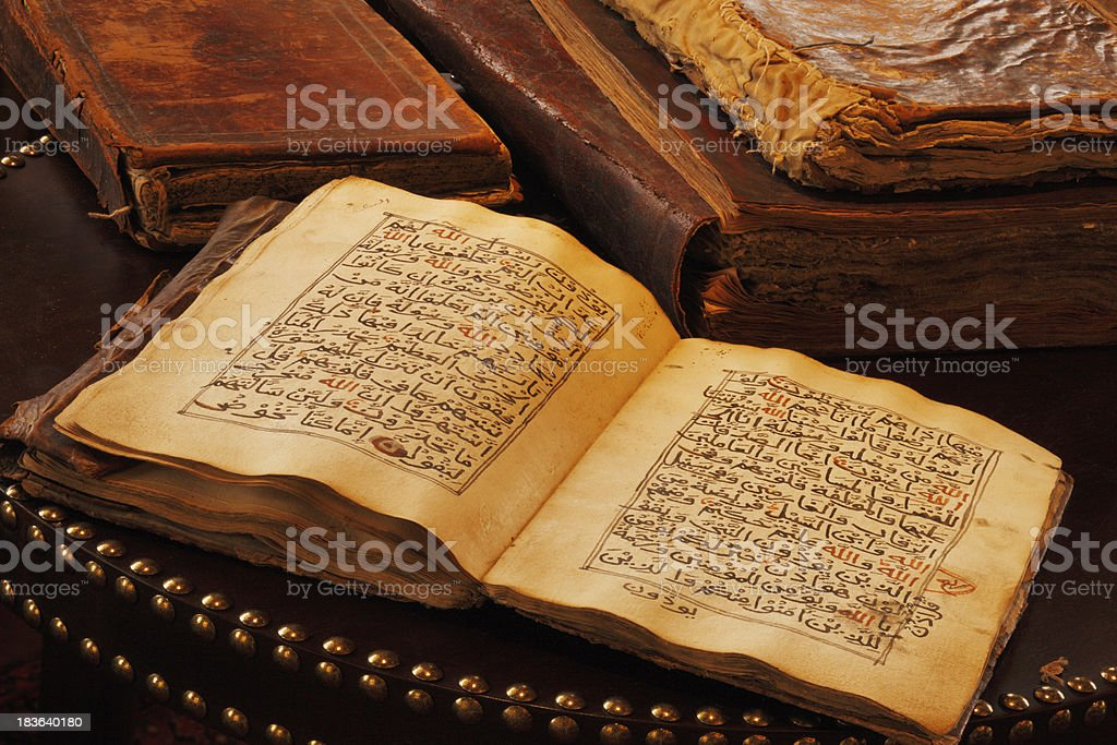 An ancient hand scripted Quran stock photo