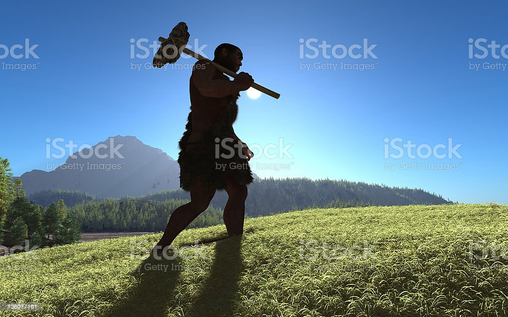 An ancient person walking up a grassy hill stock photo