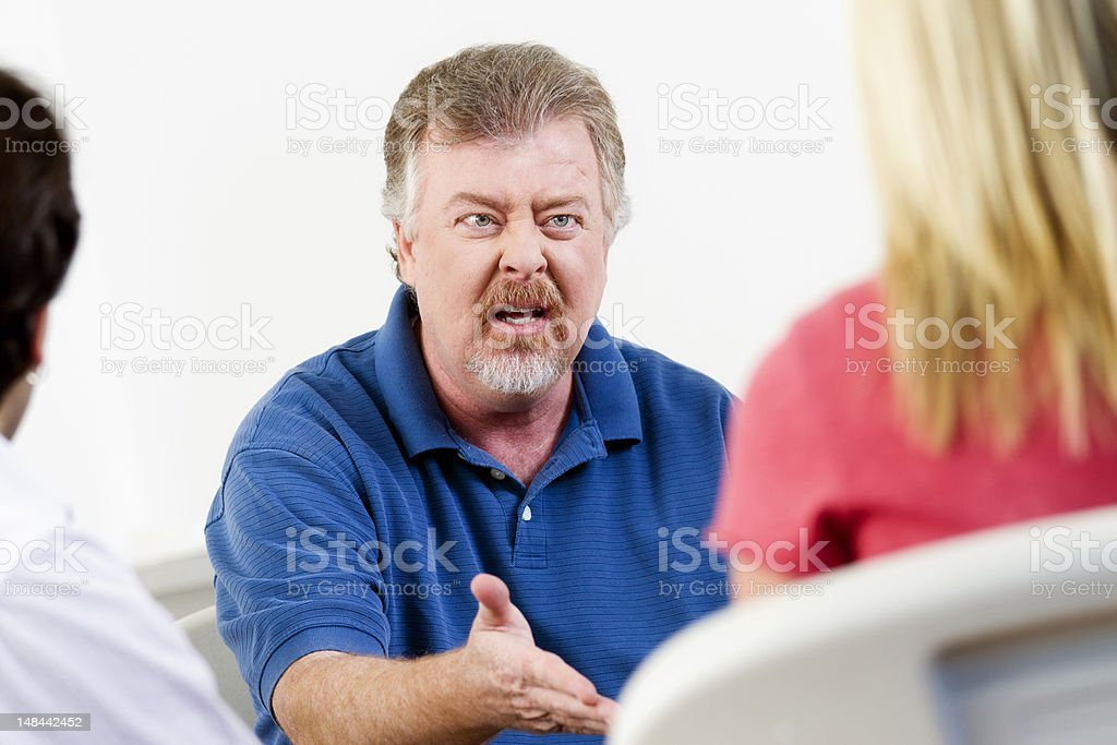 An angry boss shouting at an employee royalty-free stock photo
