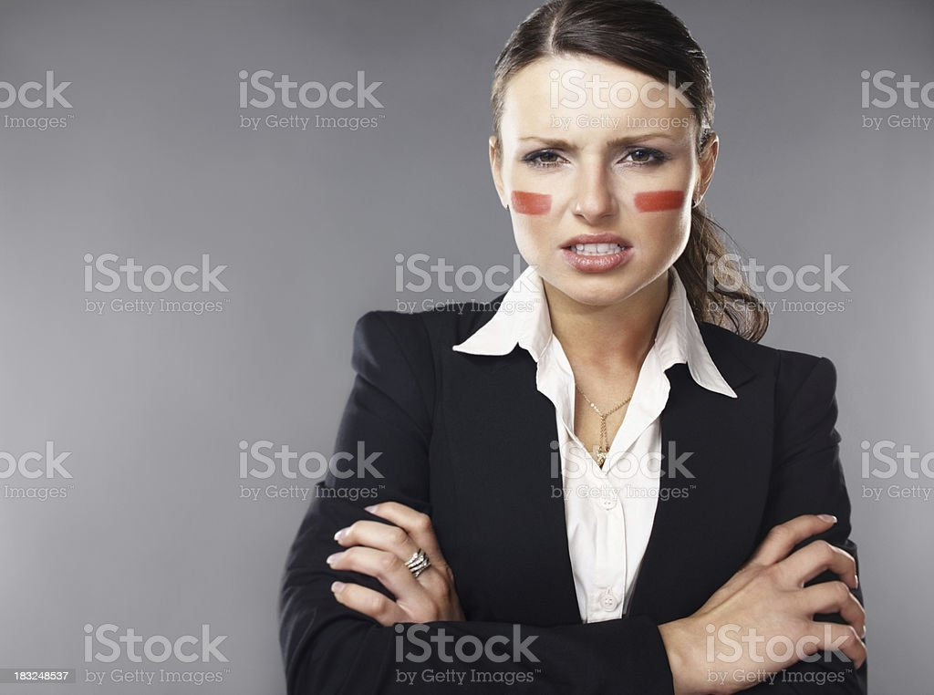 An angry young business woman with paint on her face royalty-free stock photo