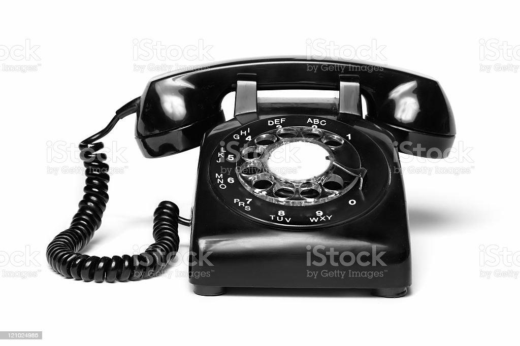 An antique black telephone on a white background  stock photo