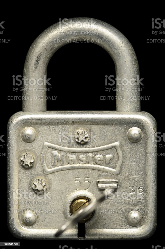An Antique Master Brand Padlock Isolated on Black royalty-free stock photo