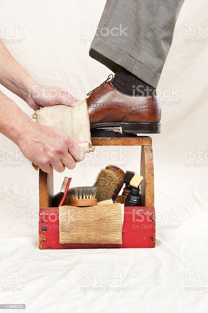 An antique shoe shining box in use stock photo
