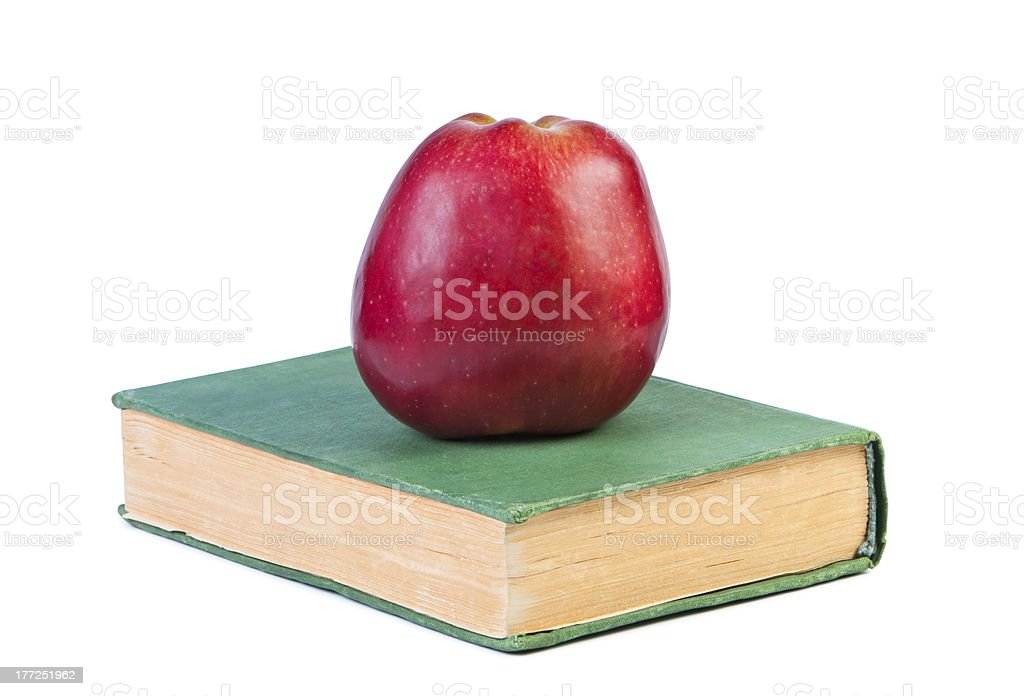 An apple on a book. royalty-free stock photo