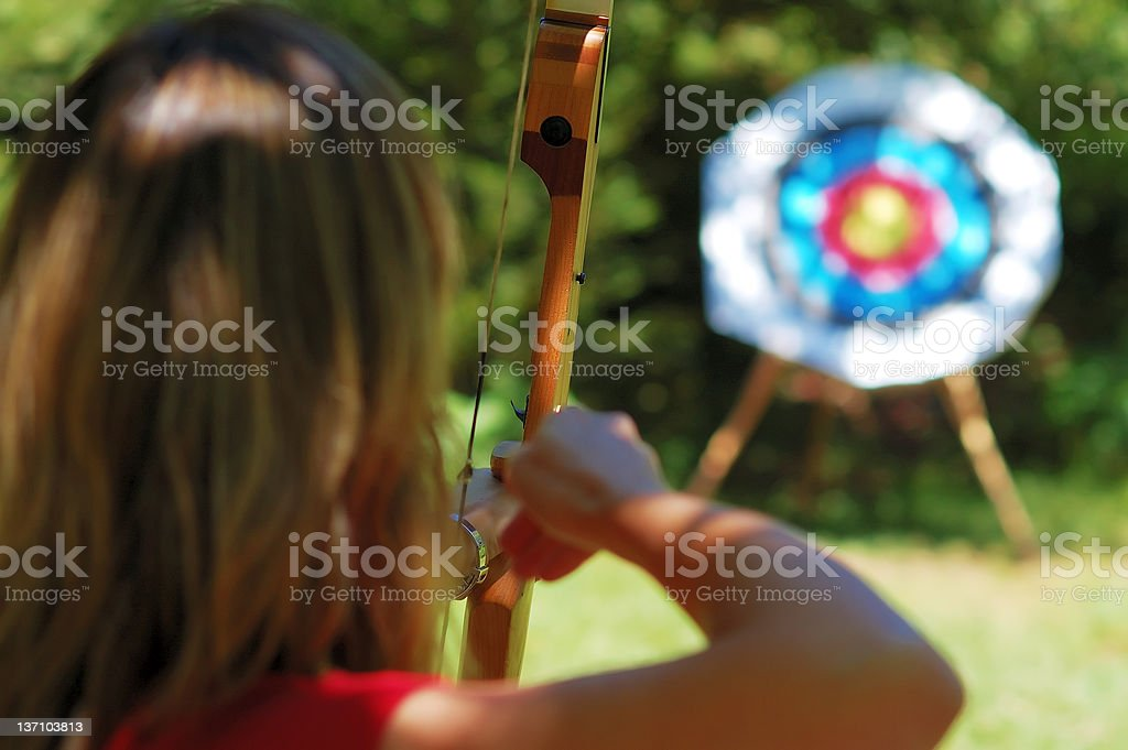 An archer aiming to hit the target  stock photo