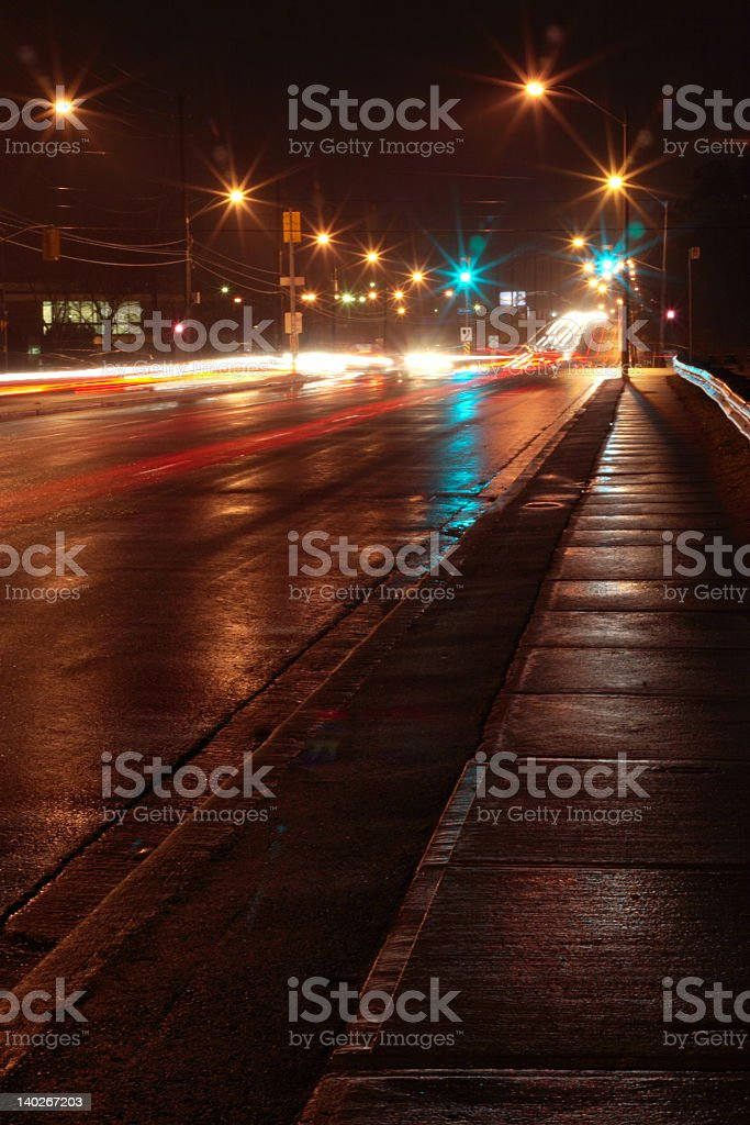 An artistic shot of a dark and rainy night in the city royalty-free stock photo