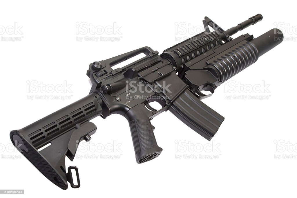 An assault rifle equipped with grenade launcher stock photo