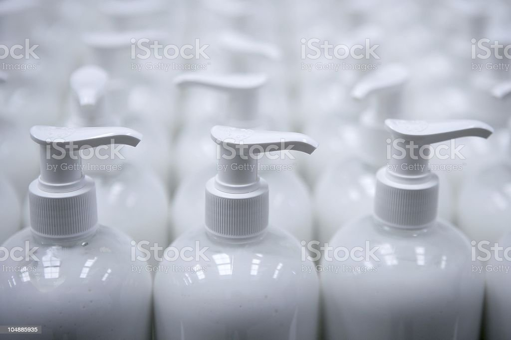 An assembly shot of plastic soap bottles in a factory stock photo