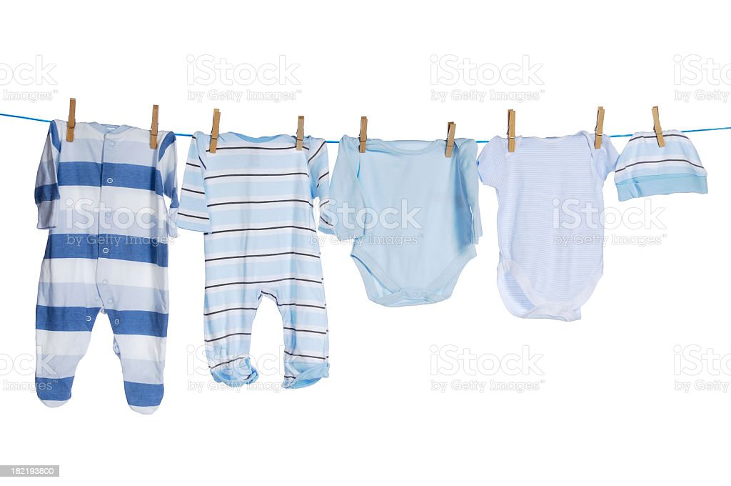 An assortment of baby clothes on display stock photo