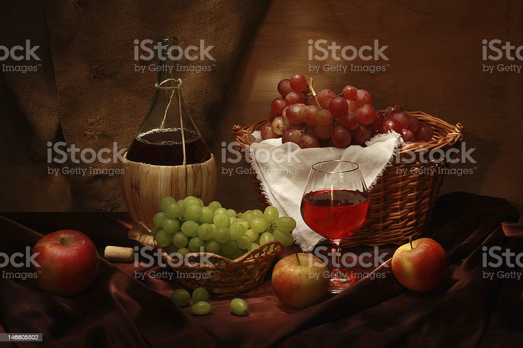 An assortment of different wines and fruits stock photo