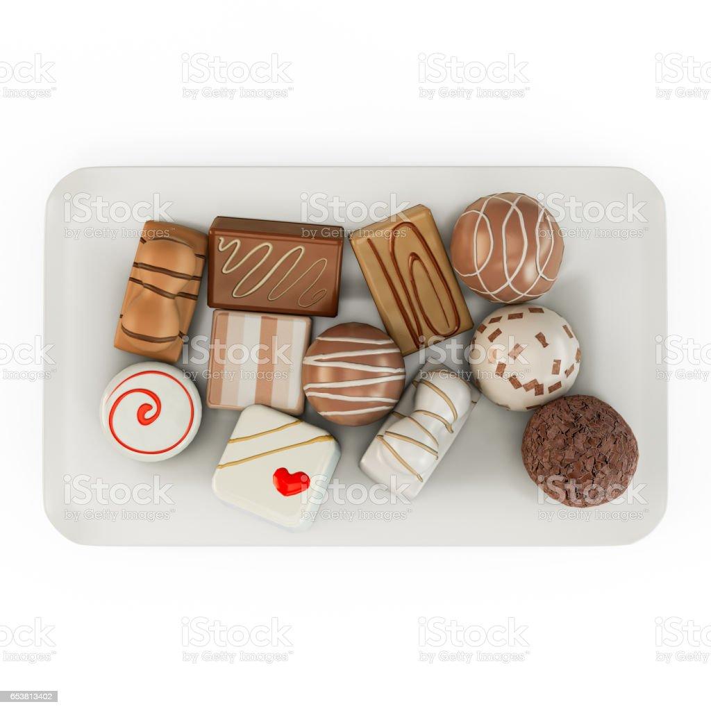 An assortment of fine chocolates in white, dark, and milk chocolate stock photo